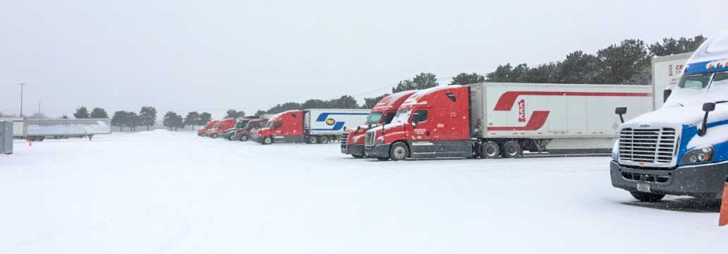 trucks on snowy lot