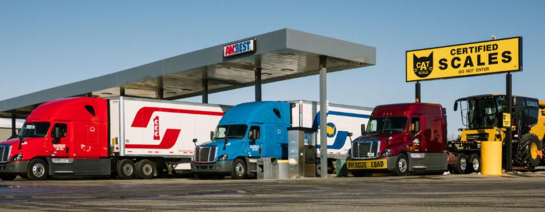 Crete, Shaffer, and Hunt trucks at filling station