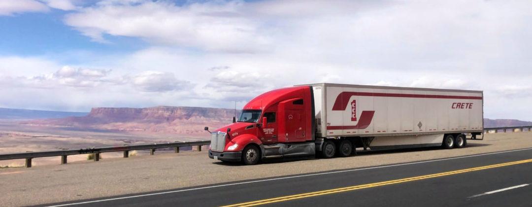 Crete dry van truck and trailer on scenic overpass