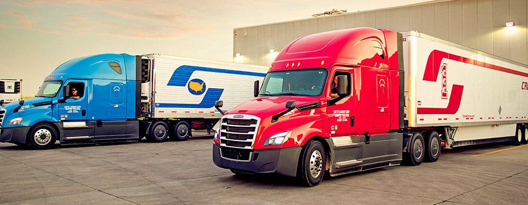 Crete Carrier and Shaffer Trucking trucks at loading dock
