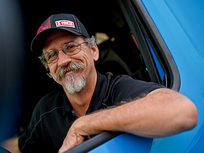 Crete Carrier driver smiling in his truck