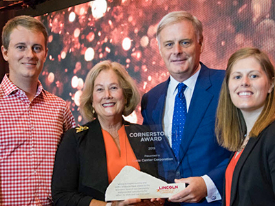 The Ostergard family accepts the Lincoln Chamber of Commerce Cornerstone Award